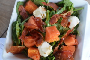 papaya, crispy proscuitto, and mozzarella salad- above close up