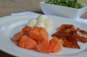 papaya, crispy proscuitto, and mozzarella salad-side shot of ingredients