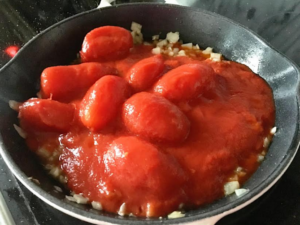 classic-marinara-adding-tomatoes